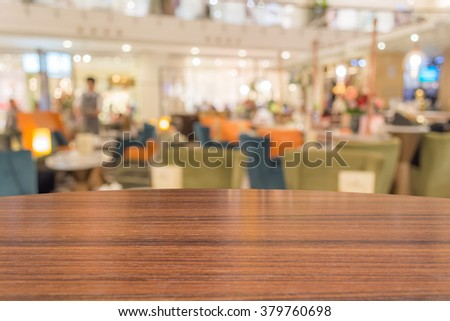 Empty wood table top on coffee shop background. can montage or display your products - stock photo