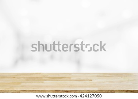 Empty wood table top with blur or defocus of abstract background image from building hallway (corridor), use for display or montage the product - stock photo