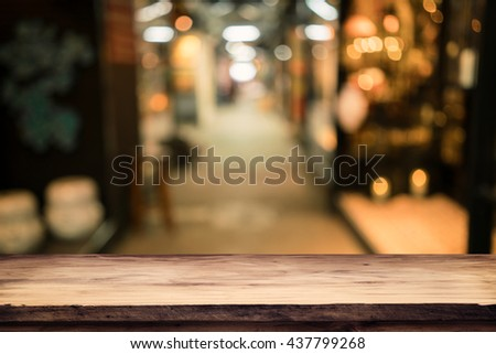 Empty wood table top with blur or defocus of abstract background image from building hallway (corridor), use for display or montage the product