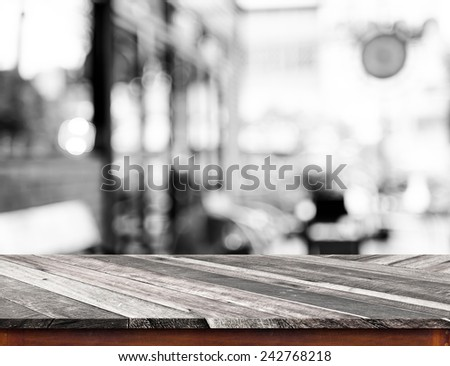 Empty wood table top with coffee shop blur with bokeh background,Product display template - stock photo
