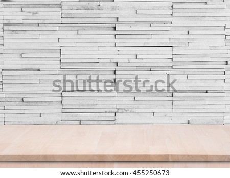 Empty wood table top with grunge cement wall background. used for display product.