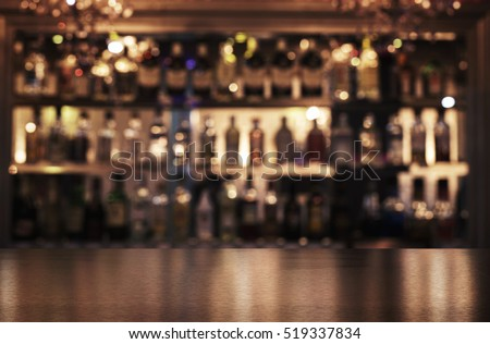 Empty Wooden Bar Counter With Defocused Background Of Restaurant, Bar Or  Cafeteria And Copy Space