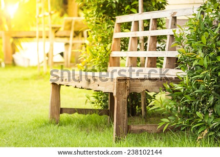 Empty wooden bench in park. - stock photo