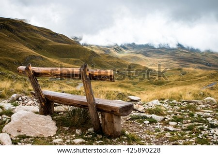 Empty wooden bench on Sedlo Pass in Durmitor National Park in Montenegro