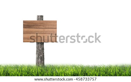 Empty wooden board in green meadow on white background with area for copy space.
