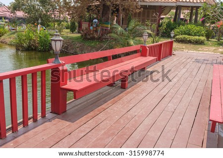 empty wooden bridge with bench