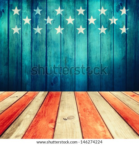 Empty wooden deck table over USA flag background. USA national holidays. Ready for product display montage. - stock photo