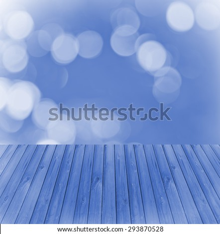 Empty wooden deck table with blue soft focus background. Ready for product display montage. - stock photo