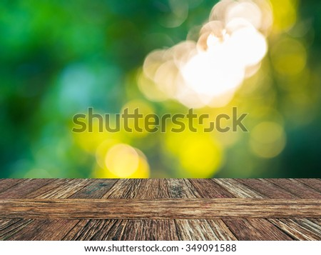Empty wooden deck table with natural bokeh background. Product display template. - stock photo