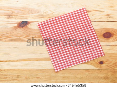 Empty wooden deck table with tablecloth on wooden table for dinner for product montage. Free space for your text. Top view horizontally. - stock photo