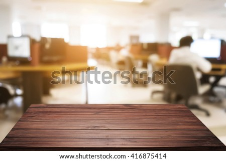 Empty wooden desk space platform and blur background of office workplace. For product display montage. - stock photo