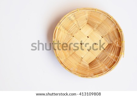 Empty wooden fruit or bread basket on white background