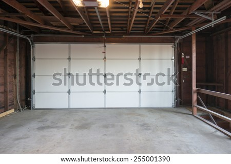 Empty wooden garage to be used as storage for junk that will be collected over the years. - stock photo