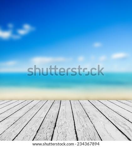 Empty wooden pier beside tropical beach - stock photo