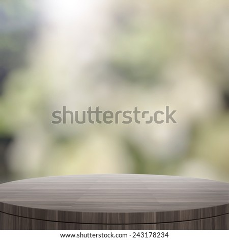 Empty wooden round table and blurred background for product presentation