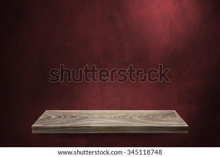 Empty Wooden shelf at concrete wall,Template mock up for display of product,business presentation.