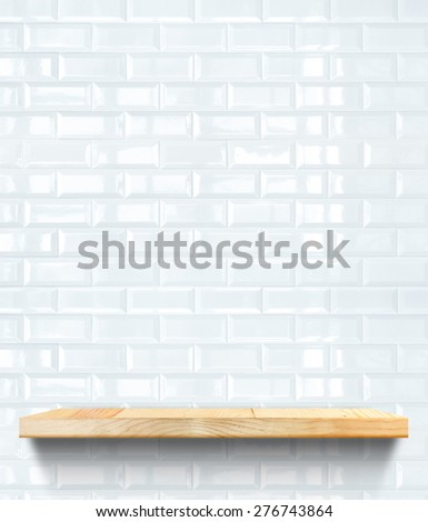 Empty Wooden shelf at white tile ceramic wall,Template mock up for display of product,business presentation - stock photo