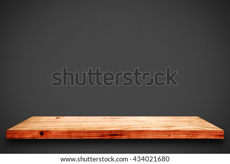 Empty wooden shelf on black gradient background. For display or montage your products.