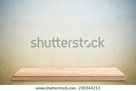Empty wooden shelf over grunge cement wall, vintage, background, template, display