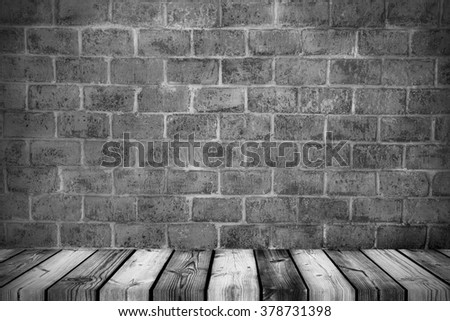Empty wooden shelf with old brick background. For product display - stock photo