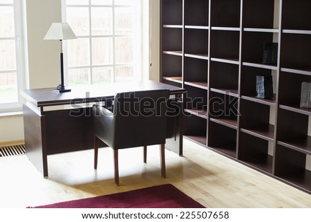 Empty wooden shelves in home office - stock photo