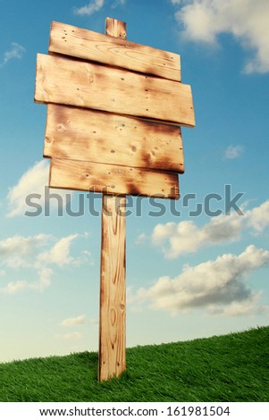 Empty wooden sign under the blue sky - stock photo