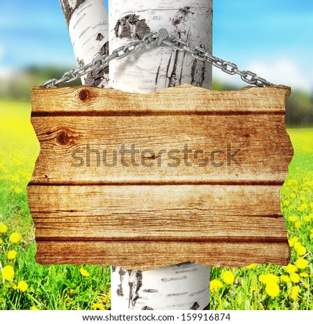 empty wooden signboard on three. 3d - stock photo