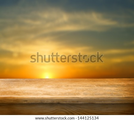 Empty wooden table and beautiful summer sunset  in background. Great for product display montages - stock photo