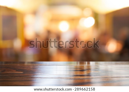 Empty wooden table and blurred cafe background, product display - stock photo