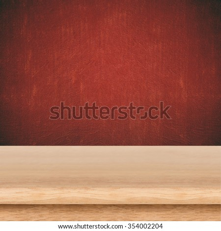 Empty wooden table and cement red background. Used for product display or montage your products