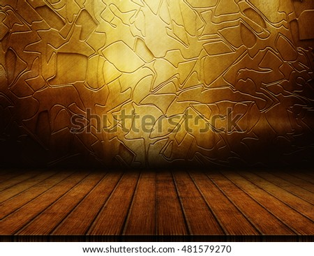 Empty wooden table and grunge gold wall for product montage and presentation. Dark interior template.