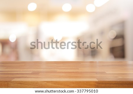 Empty wooden table and interior background, product display,blurred store with bokeh - stock photo