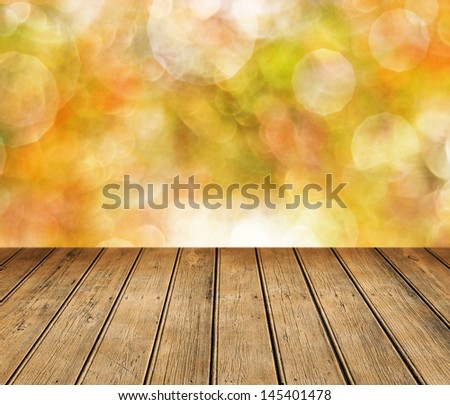 Empty wooden table for product display montages - autumn theme - stock photo