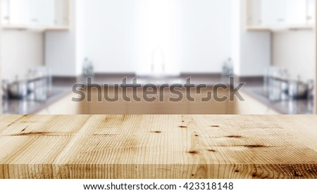 Empty wooden table in kitchen background. - stock photo