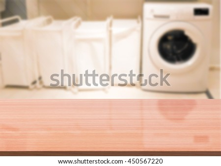 Empty wooden table on a background blur Laundry room  for display or montage your products   - stock photo