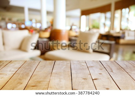 Empty wooden table on coffee shop background.