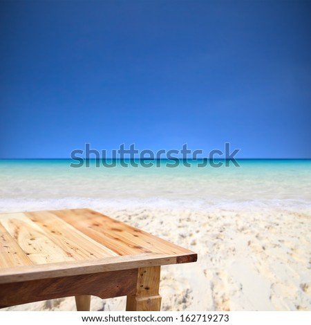Empty wooden table on the beach