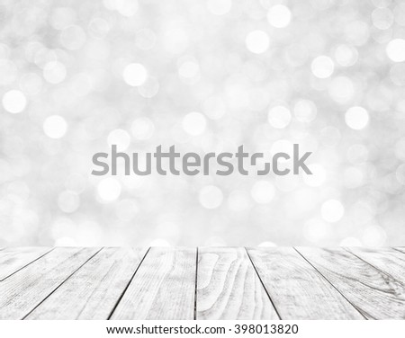 Empty wooden table on white abstract background with bokeh - stock photo