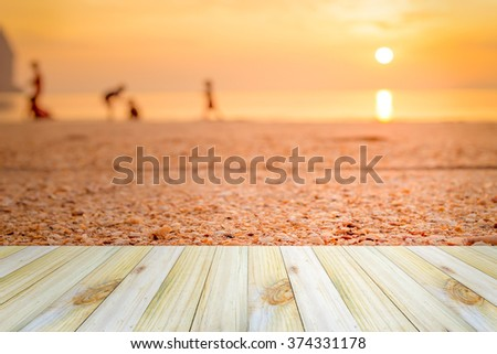 Empty wooden table or shelf wall with view of sunset or sunrise on sand beach background. For present your products. - stock photo