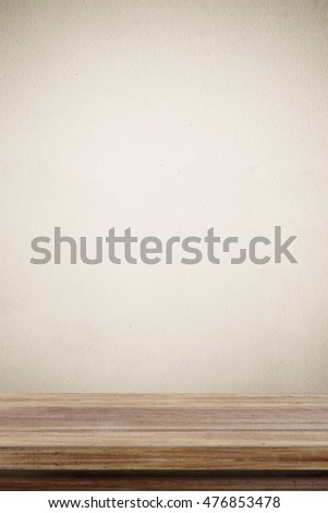 Empty wooden table over brown cement wall  background, for product display montage