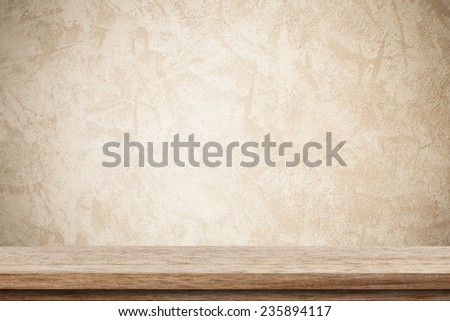 Empty wooden table over brown cement wall, vintage, background, template, display
