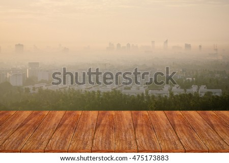 Empty wooden table over cityscape for your product display montage