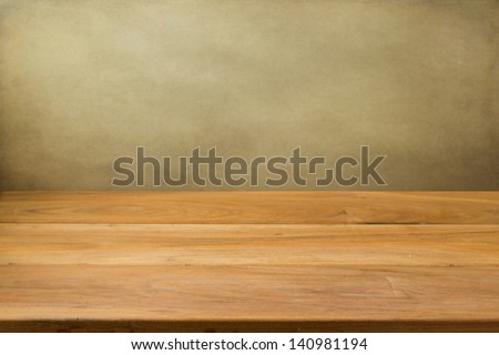 Empty wooden table over grunge background. Perfect for product montage. - stock photo