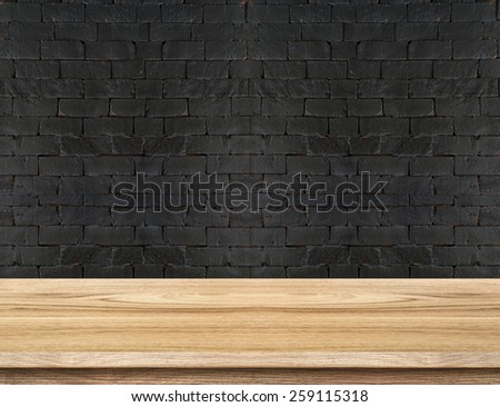 Empty Wooden Table top at black brick wall,Template mock up for display of your product. - stock photo