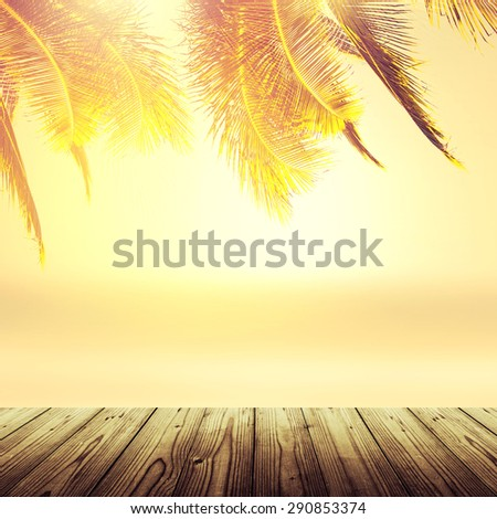 Empty wooden table. Tropical beach background with coconut palm tree and blurry ocean. Vintage effect. - stock photo