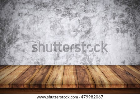 Empty wooden table with bare concrete wall background. For display or montage your products.