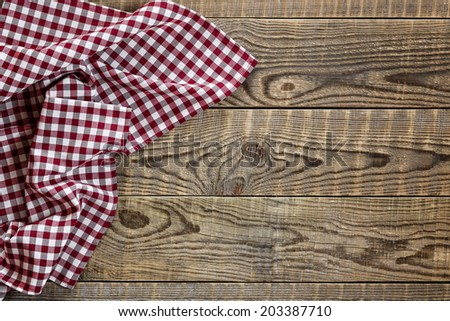 Empty wooden table with tablecloth - stock photo
