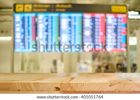 Empty wooden top table and blurred airport terminal ,For product display.  - stock photo