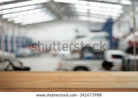 Empty wooden top table and garrage blurred background. For product display. - stock photo