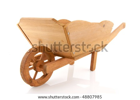 Empty wooden wheelbarrow for the garden isolated over white